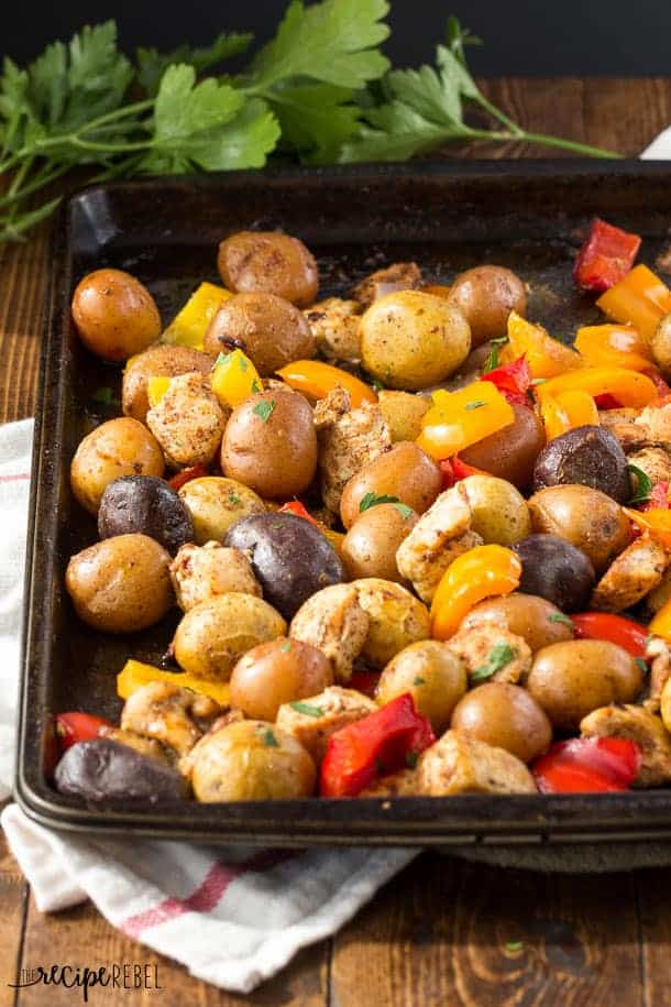 Chicken Fajita Sheet Pan Dinner: A healthy and delicious dinner made completely on one pan with no stirring! Full of chicken, potatoes, peppers and loads of fajita spices, it's the perfect quick one pot meal that requires no stirring or babysitting. www.thereciperebel.com