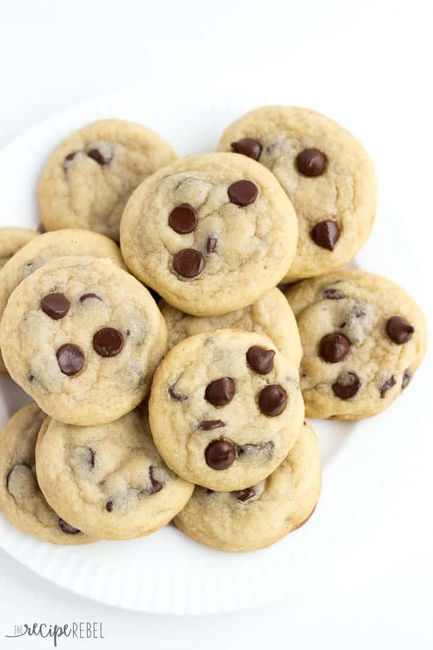 overhead image of white plate filled with chocolate chip cookies on white background