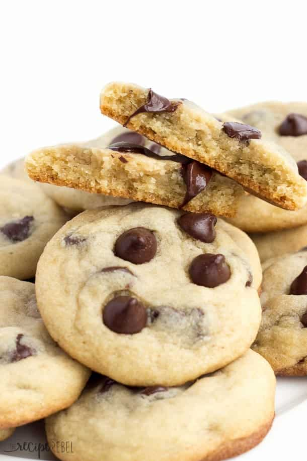 close up image of chocolate chip cookies broken in two with melty chocolate chips