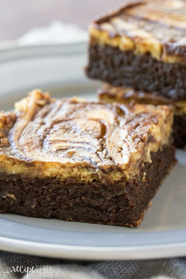 Flourless Pumpkin Cheesecake Brownies: Fudgy flourless brownies topped with pumpkin cheesecake -- a naturally gluten free treat that's perfect for Thanksgiving or the holidays! www.thereciperebel.com