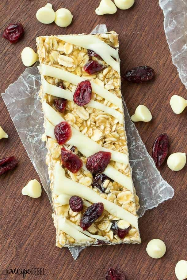 No Bake White Chocolate Cranberry Granola Bars: A super simple back to school snack or an easy no bake holiday treat! We love having granola bars in the cupboard (and they last for weeks at room temperature!) for grab and go snacks! www.thereciperebel.com