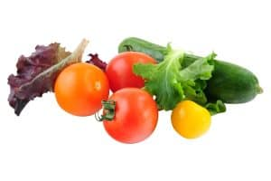 image of a variety of vegetables including greens and tomatoes