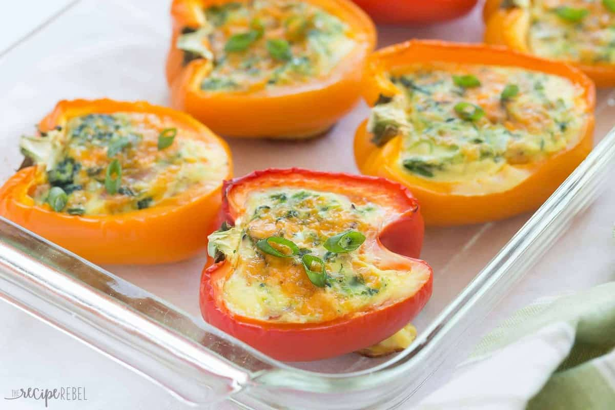 breakfast stuffed red and orange peppers in baking dish