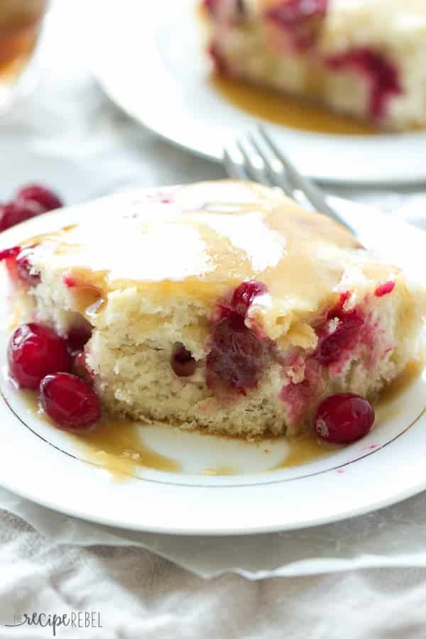 A soft, vanilla cake, loaded with cranberries topped with warm caramel sauce -- an impressive holiday dessert that is so much easier than it looks!