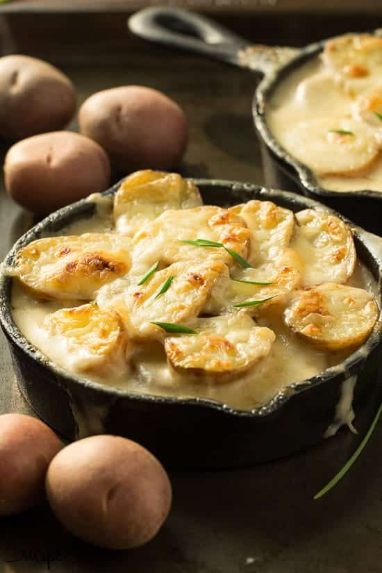 The best and easiest scalloped potatoes -- they're cooked completely in one skillet so there's no boiling the potatoes or cooking the sauce separately!