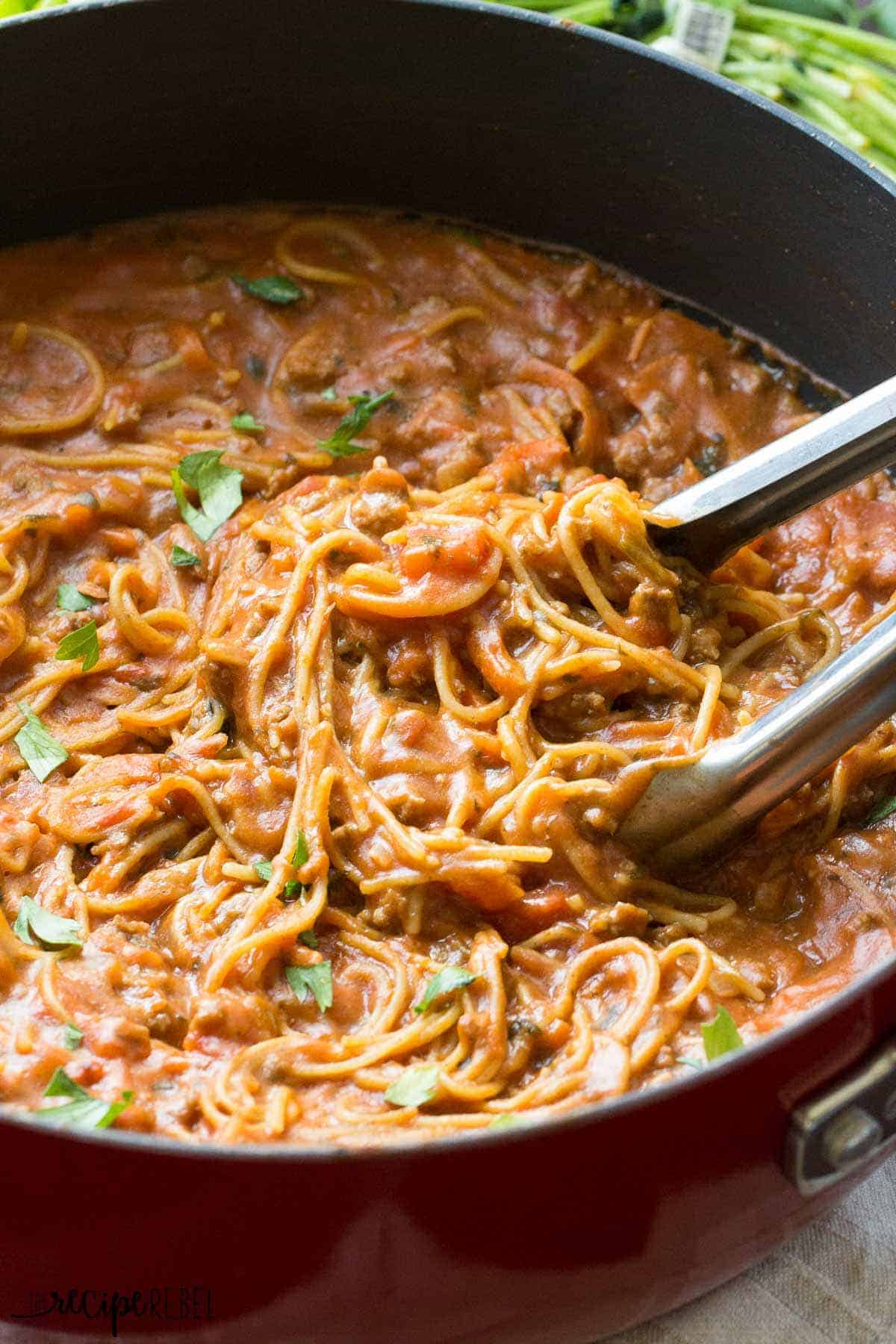 This One Pot Spaghetti and Meat Sauce is a healthy, easy and delicious meal for any night of the week! Made healthier with hidden veggies and one other secret ingredient I bet you'll never guess!