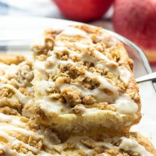 From scratch cinnamon buns stuffed with apples, topped with crunchy brown sugar streusel and topped with maple glaze -- the ultimate cinnamon roll for fall!