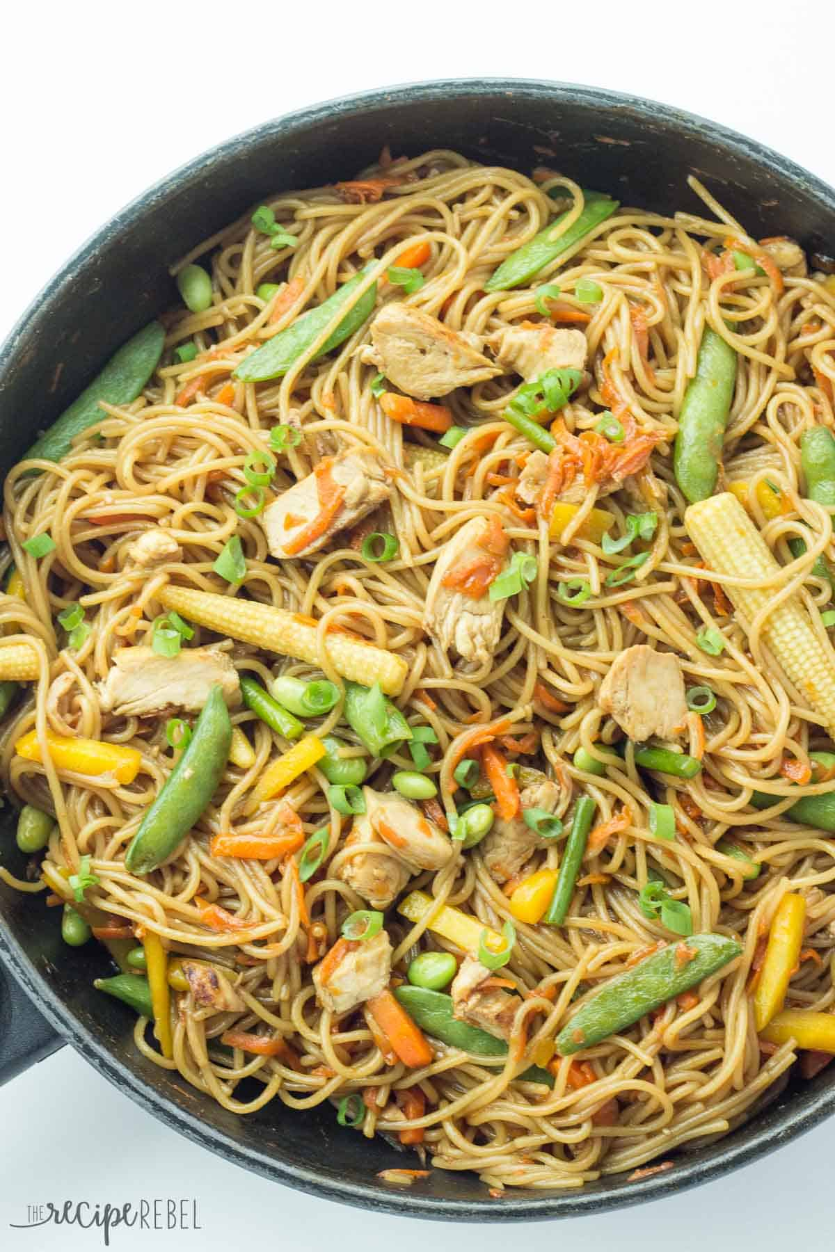 overhead image of black skillet with one pot chicken chow mein