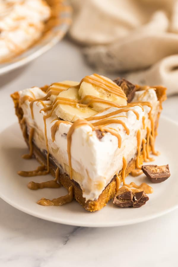 slice of banana cream pie with peanut butter drizzle