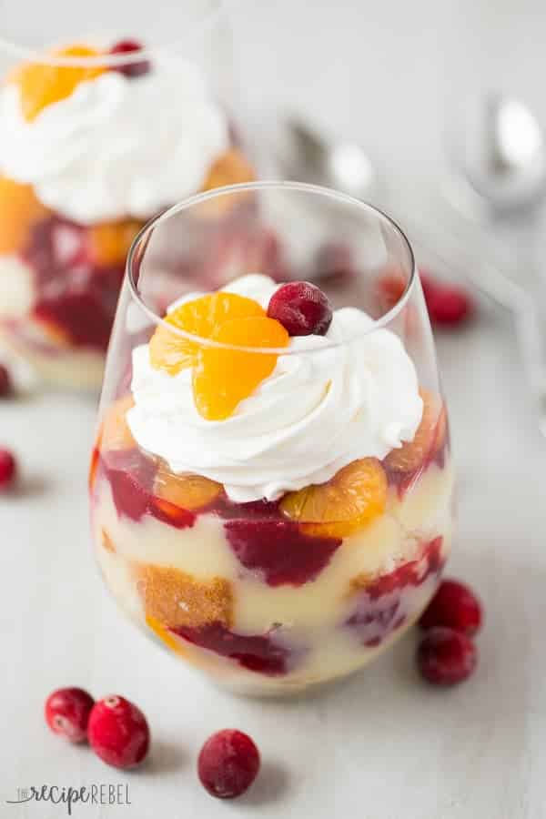 Vanilla cake, vanilla pudding, oranges and cranberry sauce layered together for the perfect holiday dessert -- this Cranberry Orange Trifle is great for potlucks!