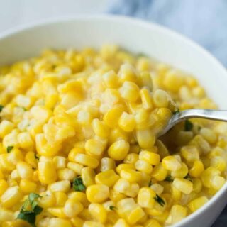 This Slow Cooker Creamed Corn is so easy -- just mix it together and throw it in! It has no cream and is a healthier, dairy free option that tastes just as good!