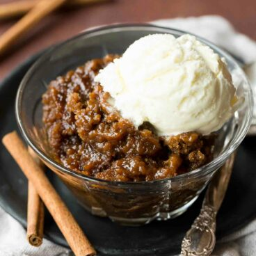 An easy make ahead dessert perfect for the holidays! This spiced Gingerbread Pudding Cake cooks in the slow cooker and keeps your oven free.