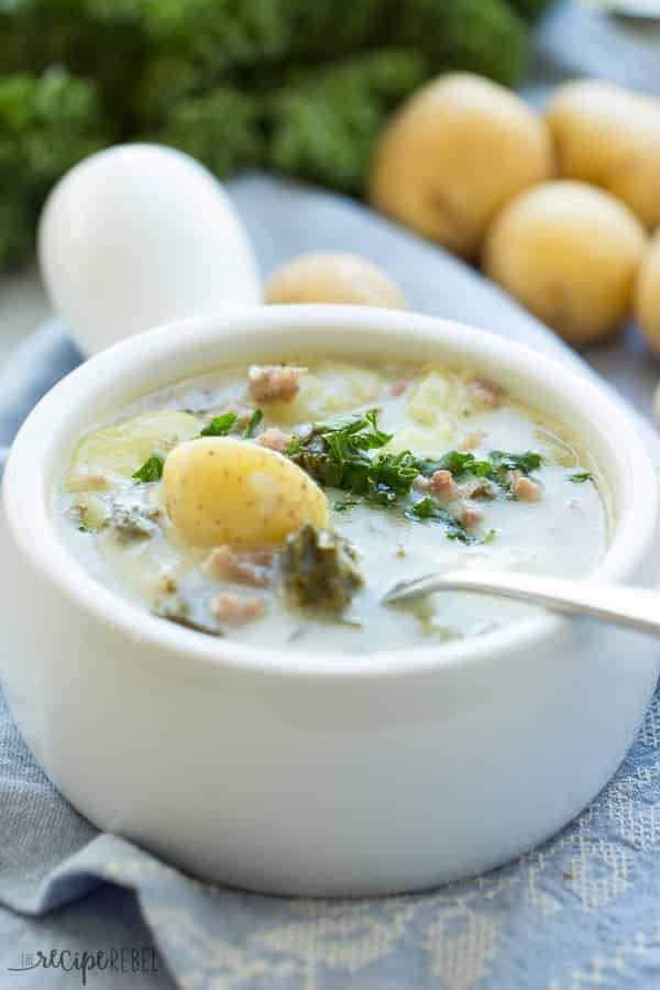 An easier version of Zuppa Toscana made in the slow cooker or crock pot. Full of Italian sausage, kale, and Creamer potatoes, it's hearty, creamy, and perfect for fall!