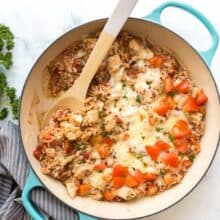caprese chicken and rice overhead with scoop