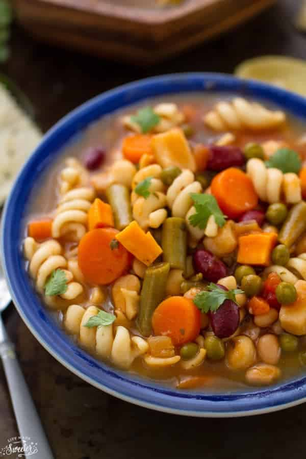 hearty vegetable soup with noodles carrots beans peas and squash