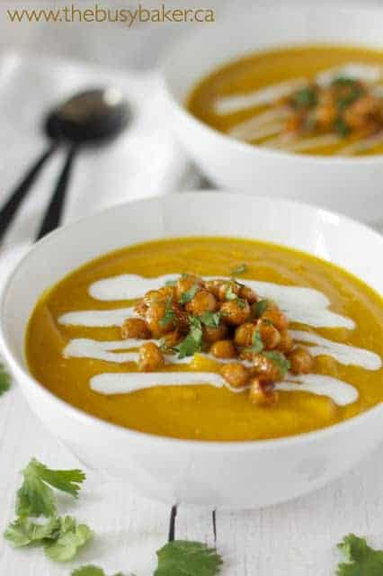 butternut squash red lentil soup in white bowl with crispy chickpeas