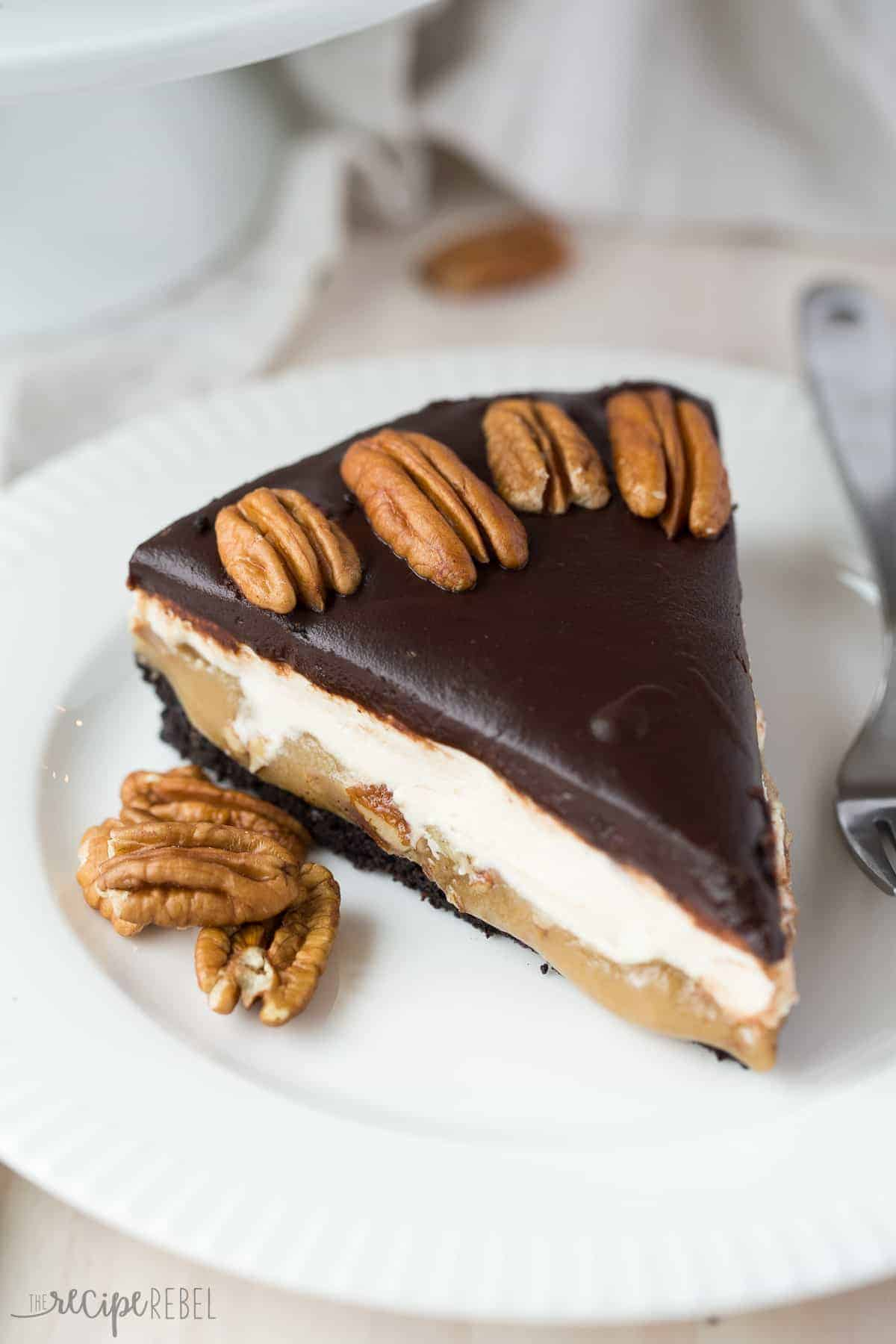An Oreo cookie crust, a layer of pecans and caramel, a cheesecake layer and chocolate ganache make up this Almost No Bake Turtle Cheesecake! The crust bakes 10 minutes, and the rest sets up in the fridge.