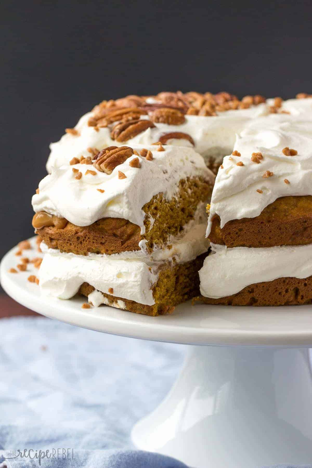 A moist, pumpkin spice cake layered with thick caramel, pecans, and whipped cream -- the perfect holiday dessert!