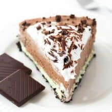 A chocolate cookie crust (baked only 10 minutes!) topped with creamy mint filling and topped with rich, luscious no bake chocolate cheesecake filling! Top it with whipped cream and chocolate curls for an impressive make ahead holiday dessert!