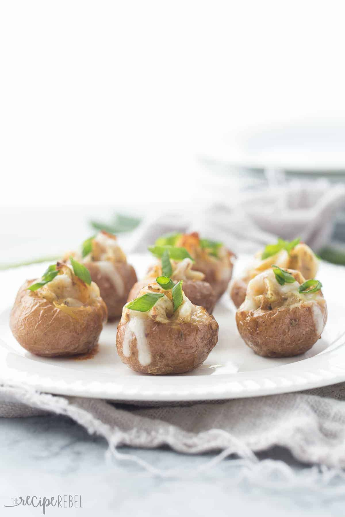 These mini Twice Baked Potatoes are a simple appetizer or even side dish that everyone will love -- creamy, perfectly seasoned, cheesy potatoes stuffed inside a tender potato shell!