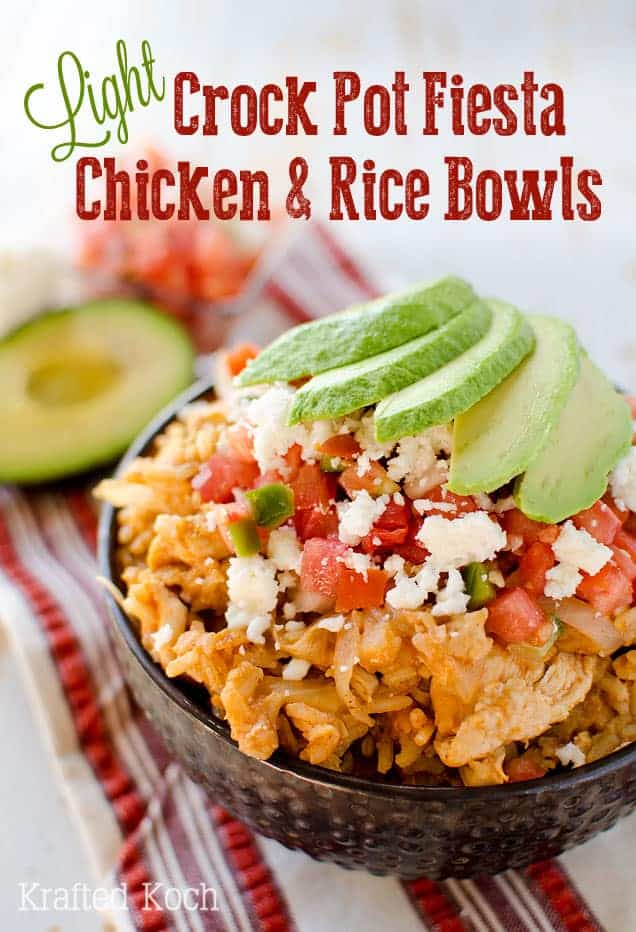 crockpot fiesta chicken and rice bowls topped with tomato and avocado slices