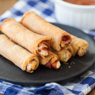 These Easy Pizza Roll Ups are stuffed with pepperoni and cheese -- perfect for dunking in pizza sauce!