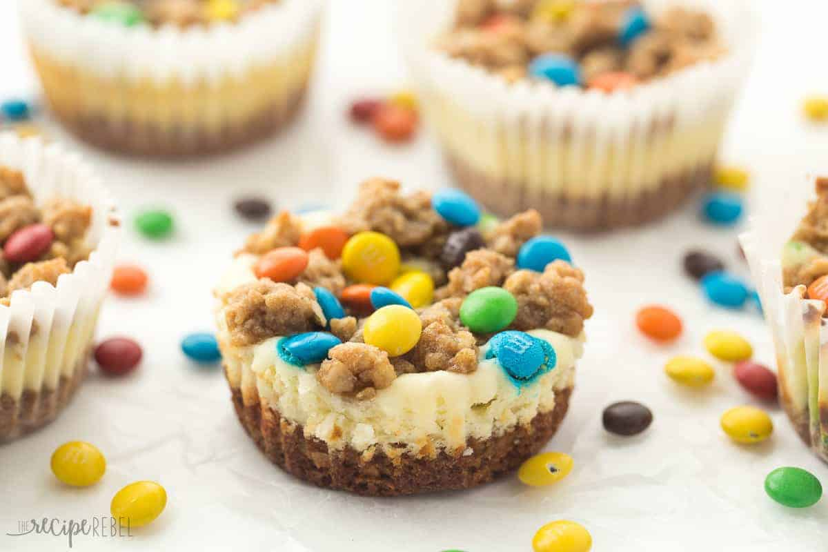 These Monster Cookie Cheesecakes are made with a naturally gluten free peanut butter oatmeal cookie base and M&M's, and they're the perfect treat for any celebration! Because peanut butter + cookie + cheesecake + candy.