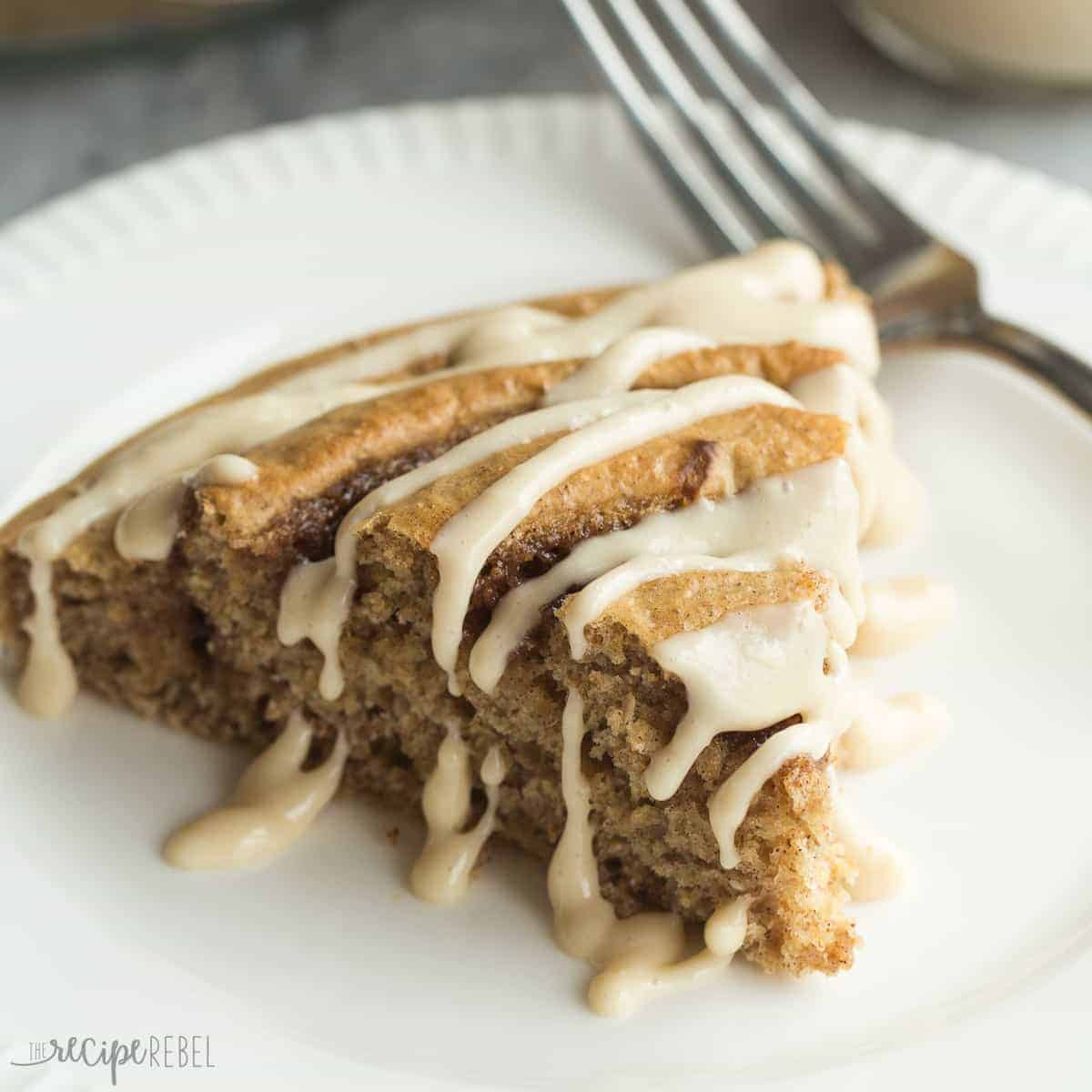 This Healthier Cinnamon Roll Baked Pancake is whole wheat, low in sugar, and bakes in a pie plate so there's no flipping or waiting! Drizzle with easy Maple Cream Cheese Syrup for a special treat!