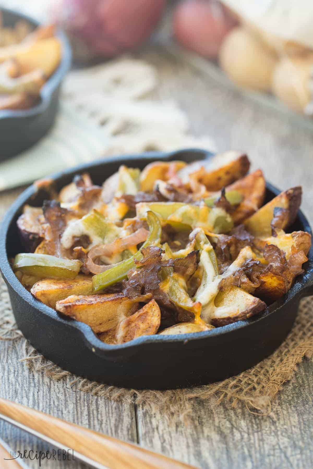 Seasoned crispy potato wedges topped with sauteed peppers, onions, roast beef and cheese -- these Philly Cheesesteak Potato Wedges are the perfect appetizer (or meal in one!) for your next game day or get together!
