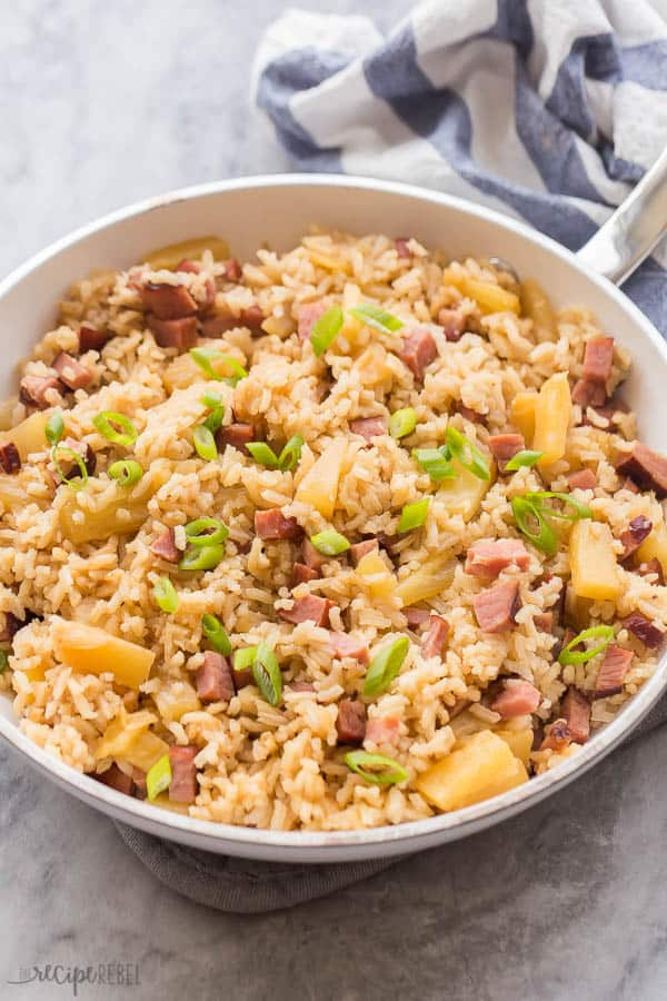 ham and pineapple rice in white pan on marble with white and blue towel