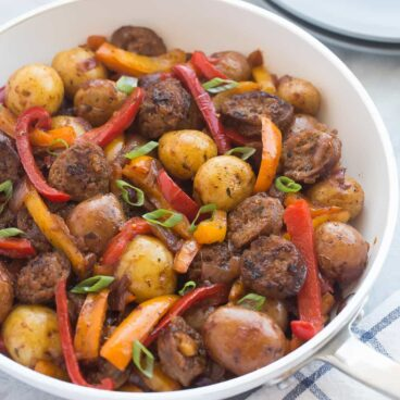 The BEST, EASIEST meal I've made in a long time! This 30 Minute BBQ Sausage, Peppers and Potato Skillet is a hearty, healthy, easy meal that only needs one pot, and it's gluten free!