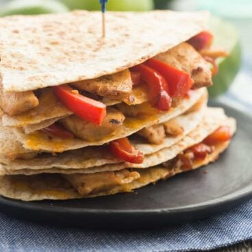 Honey Lime Chicken Quesadillas are filled with chicken, peppers, onions and cheese and are the perfect easy weeknight or summer meal! My whole family LOVES these!