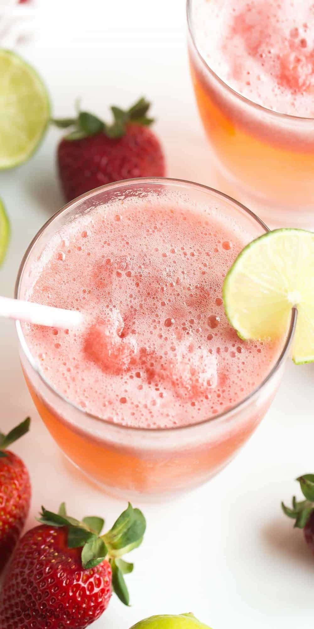 This Berry Lime Slush is a cold, frosty summer drink that will keep your thirst quenched! It's great for storing in the freezer and pulling out for surprise visitors, picnics and barbecues! https://www.thereciperebel.com/berry-lime-slush-recipe/
