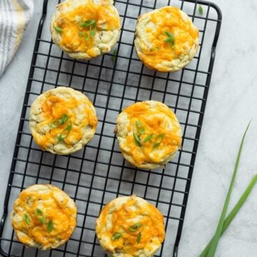 My kids LOVE the cheesy surprise in these Cheese Stuffed Mashed Potato Puffs! Leftover mashed potatoes make these SO easy (or use fresh!) -- perfect make ahead side or appetizer for holiday gatherings. https://www.thereciperebel.com/cheese-stuffed-mashed-potato-puffs/