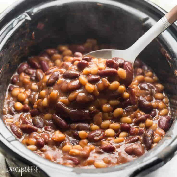 healthier slow cooker maple balsamic baked beans in black crockpot