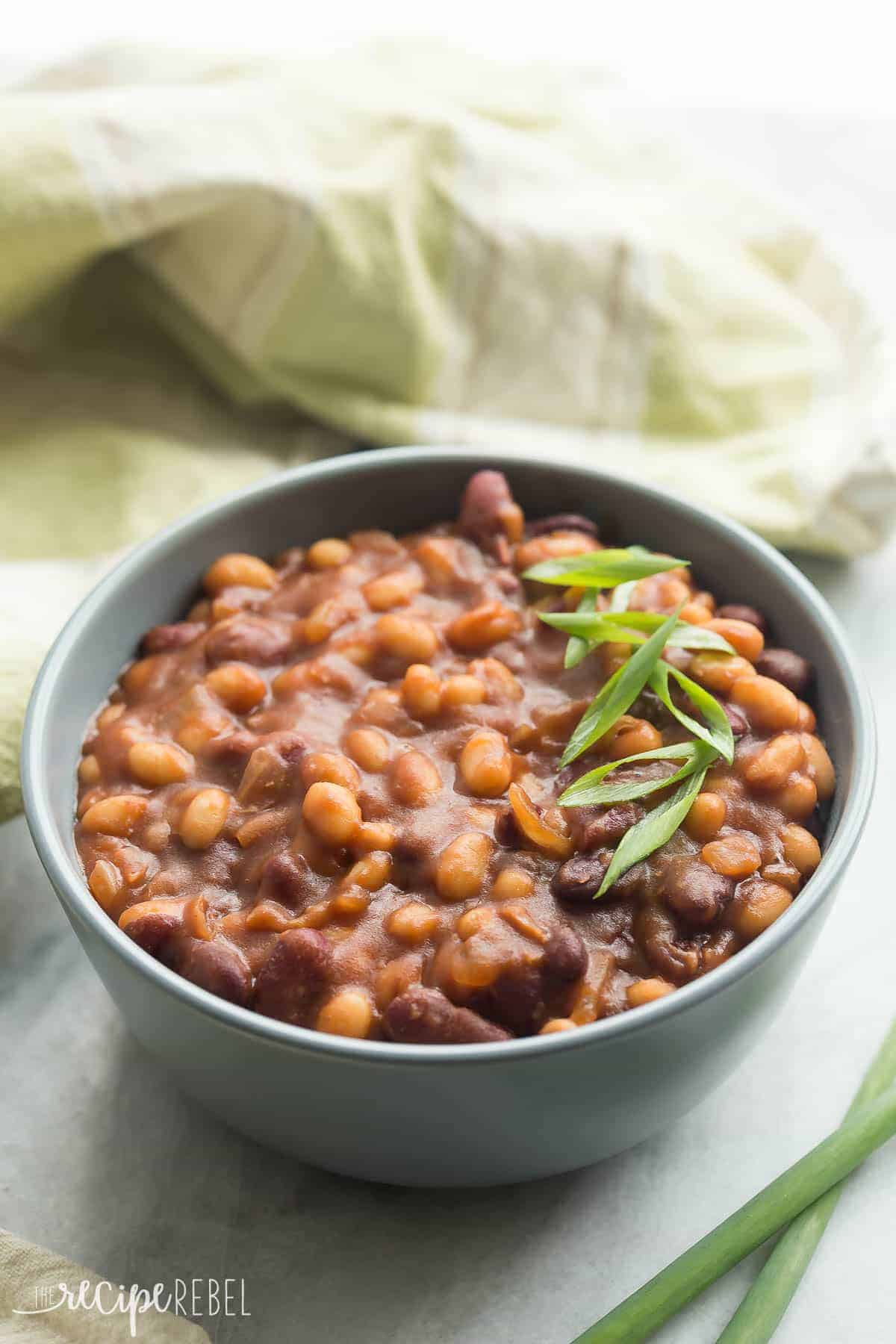 We LOVE these for summer barbecues! Healthier Slow Cooker Baked Beans that pack a big punch of flavor with maple syrup and balsamic vinegar -- great cold or warm! Gluten free. www.thereciperebel.com