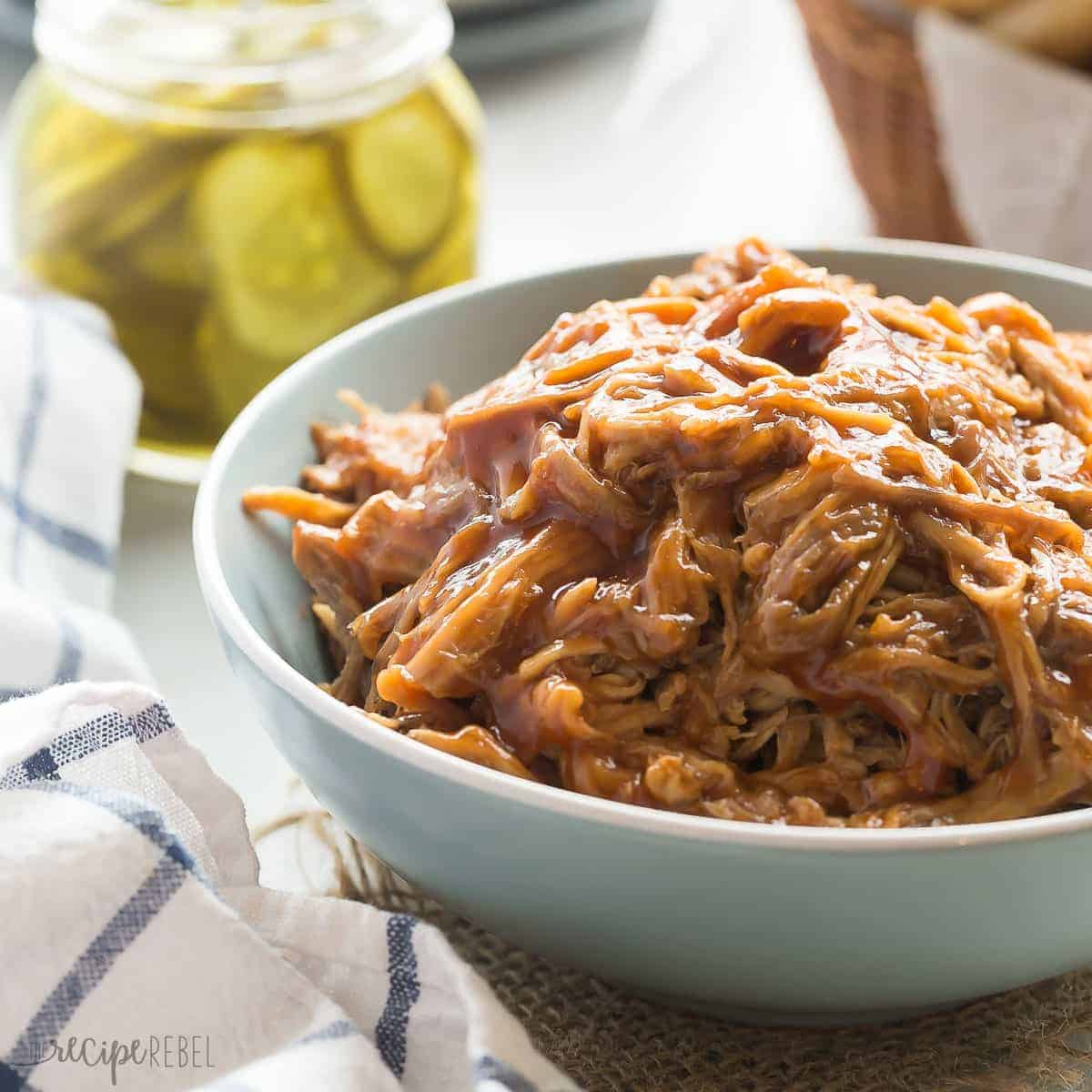 This easy Slow Cooker Pineapple Brown Sugar Pulled Pork recipe is smothered in homemade pineapple brown sugar barbecue sauce! Sweet, tangy and so tender! https://www.thereciperebel.com/slow-cooker-pineapple-brown-sugar-pulled-pork/