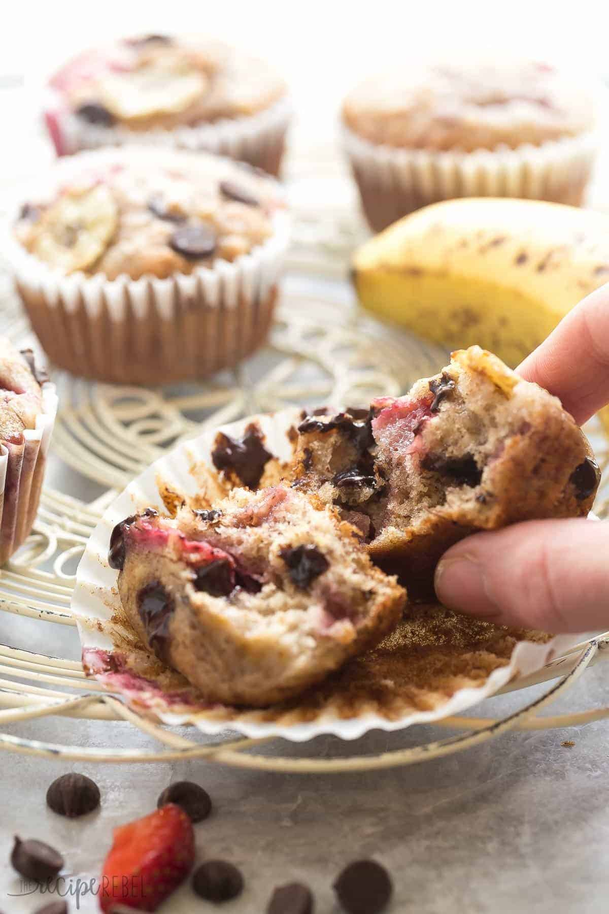 These Chocolate Chip Banana Muffins are the best -- so moist but made healthier with whole wheat flour, yogurt and loaded with fresh strawberries!