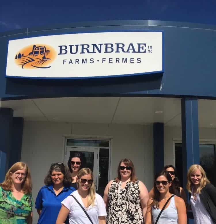 group of women outside of burnbrae farms office
