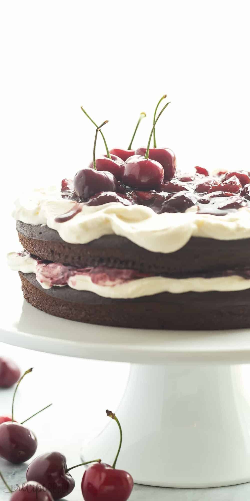 This Black Forest Cake is SO EASY and naturally gluten free -- and no gluten lover would ever know the difference! Chocolate Cake is layered with real whipped cream and homemade cherry sauce! www.thereciperebel.com