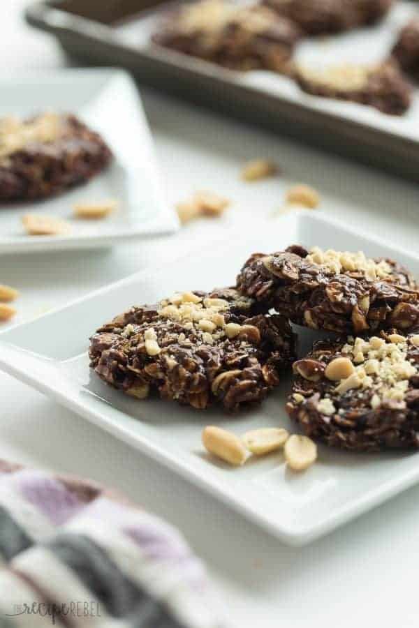 healthier chocolate peanut butter no bake cookies on a white plate with chopped peanuts