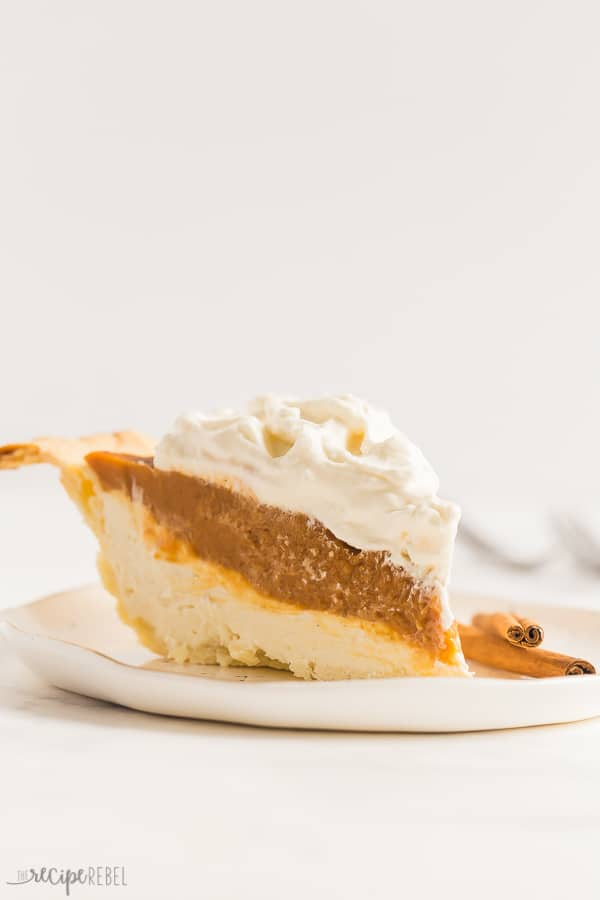 slice of cream cheese pumpkin pie up close on white plate with white background