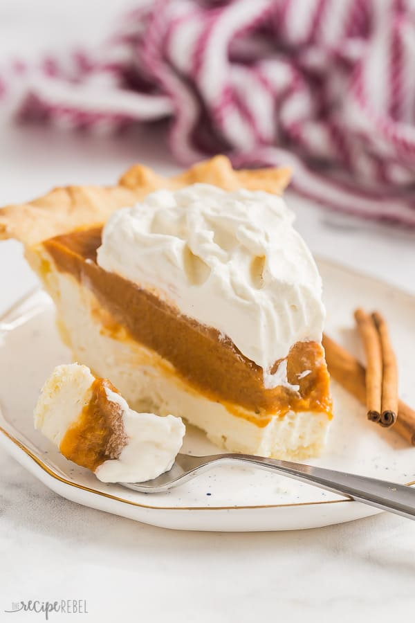 cream cheese pumpkin pie white plate with bite taken out on fork