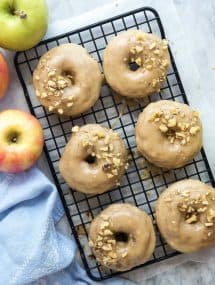 These Apple Cinnamon Baked Donuts are packed with apples (healthy, right?!) and cinnamon -- the perfect fall treat! Smothered in a brown sugar glaze that makes these a decadent dessert or special breakfast :)