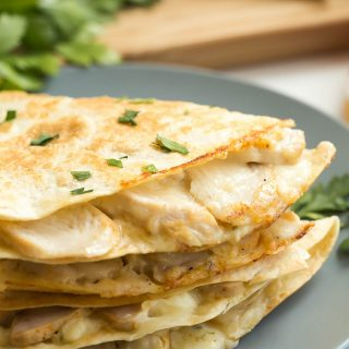 These Chicken Alfredo Quesadillas are an easy lunch, dinner or snack! They're filled with leftover chicken, Alfredo sauce and cheese -- easy comfort food! A 10 minute meal.