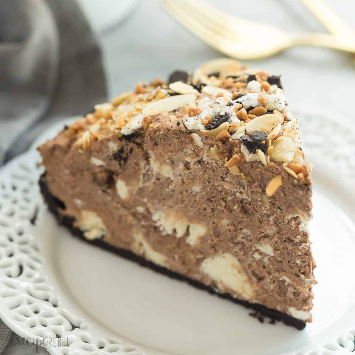 Sometimes you just need a mountain of chocolate! This Chocolate Explosion has rich chocolate mousse piled high on an Oreo crust, filled with chunks of vanilla cheesecake, Oreos, nuts, toffee bits -- truly indulgent!