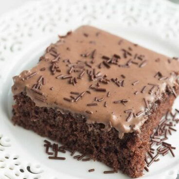 These Frosted Texas Brownies are made with a whisk and a bowl -- no mixer required! They make a huge sheet pan and are perfect for potlucks!