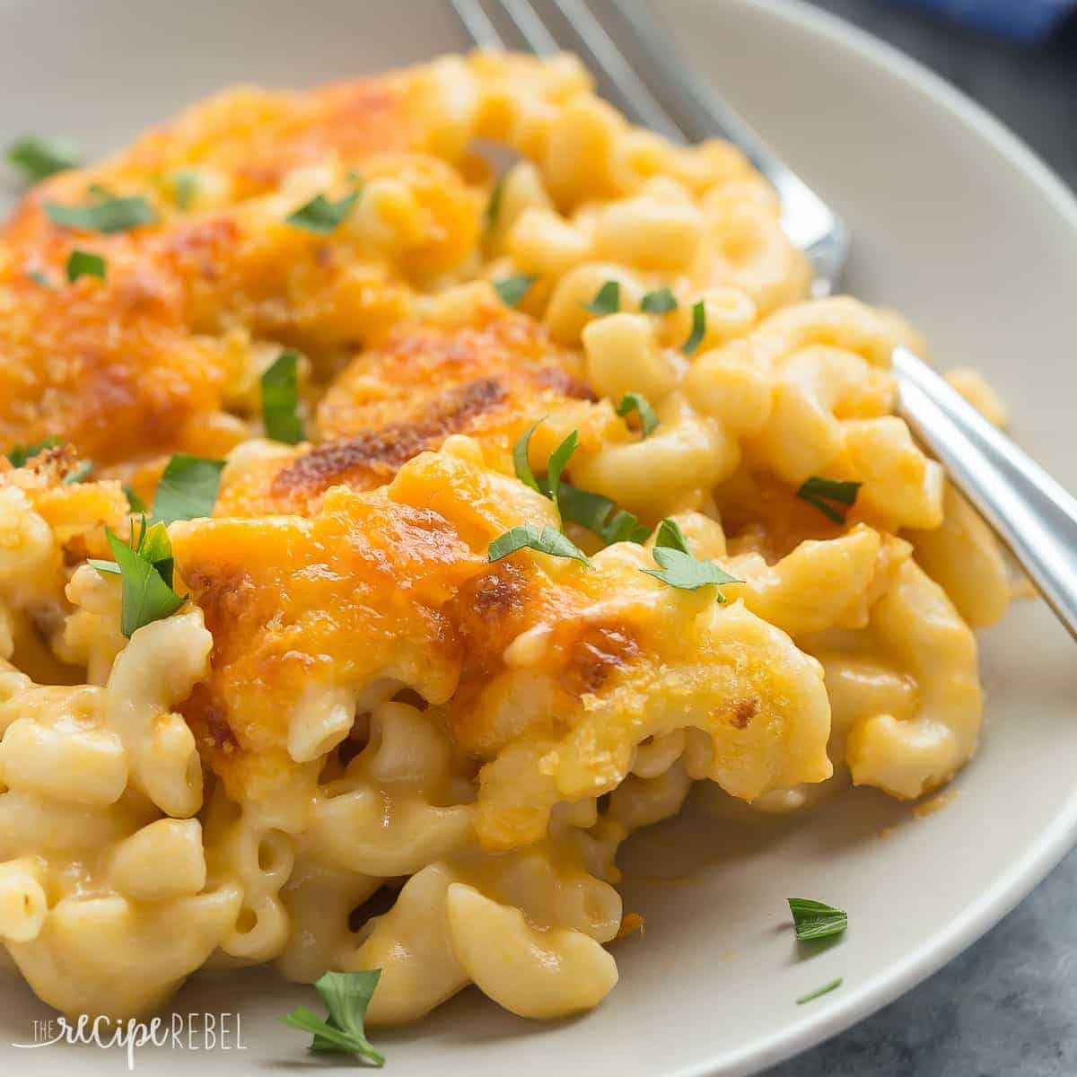 This Healthier Baked Mac and Cheese is made with whole wheat pasta, low fat milk, and chicken broth but is just as creamy and cheese as ever! It's a great make ahead meal for those busy weeknights!