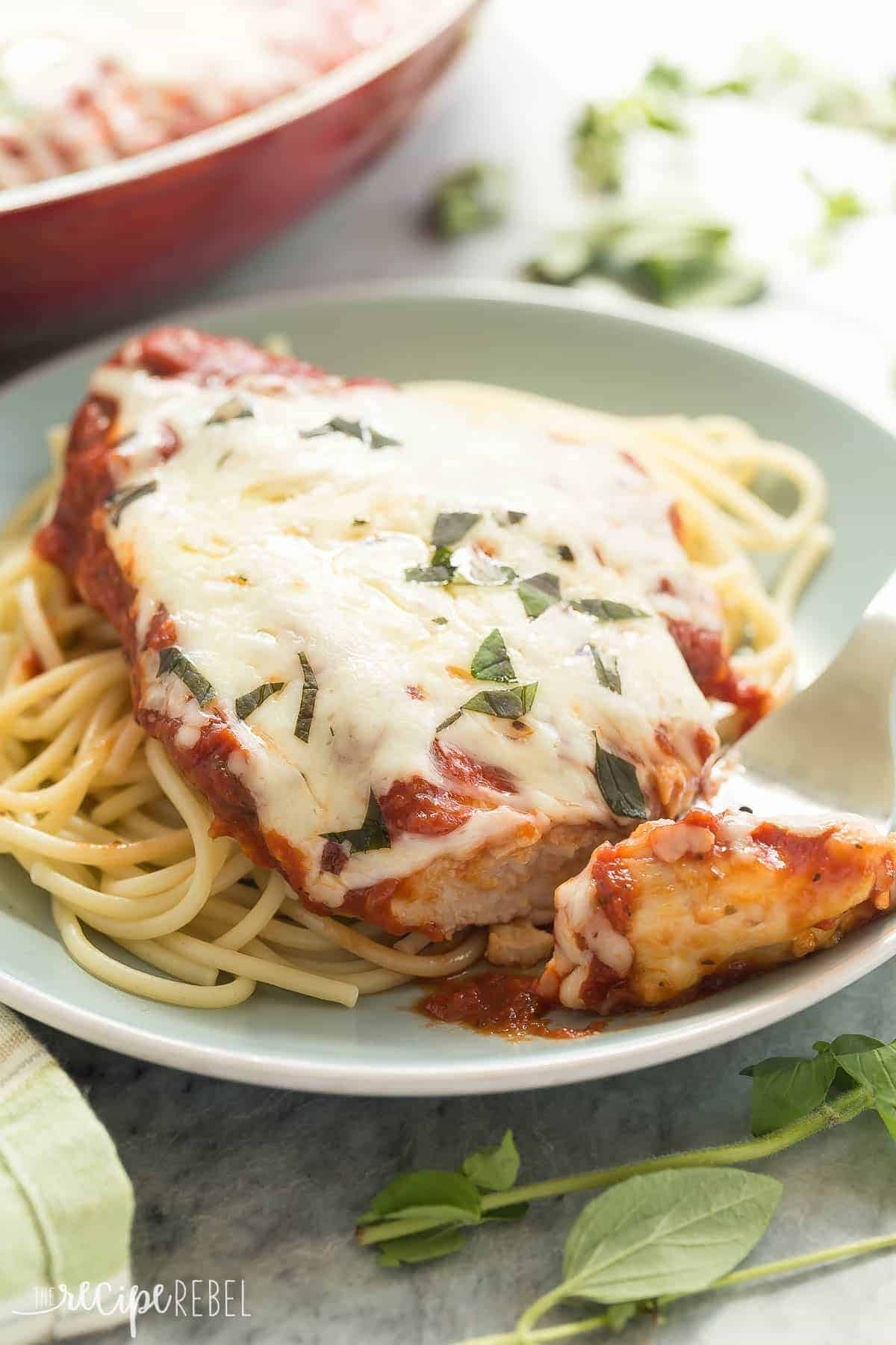 This Skillet Chicken Parmesan is made healthier with a homemade tomato sauce, skinless chicken breasts and no breading or frying (which means it's also gluten free)! It's a 30 minute meal that everyone will love!