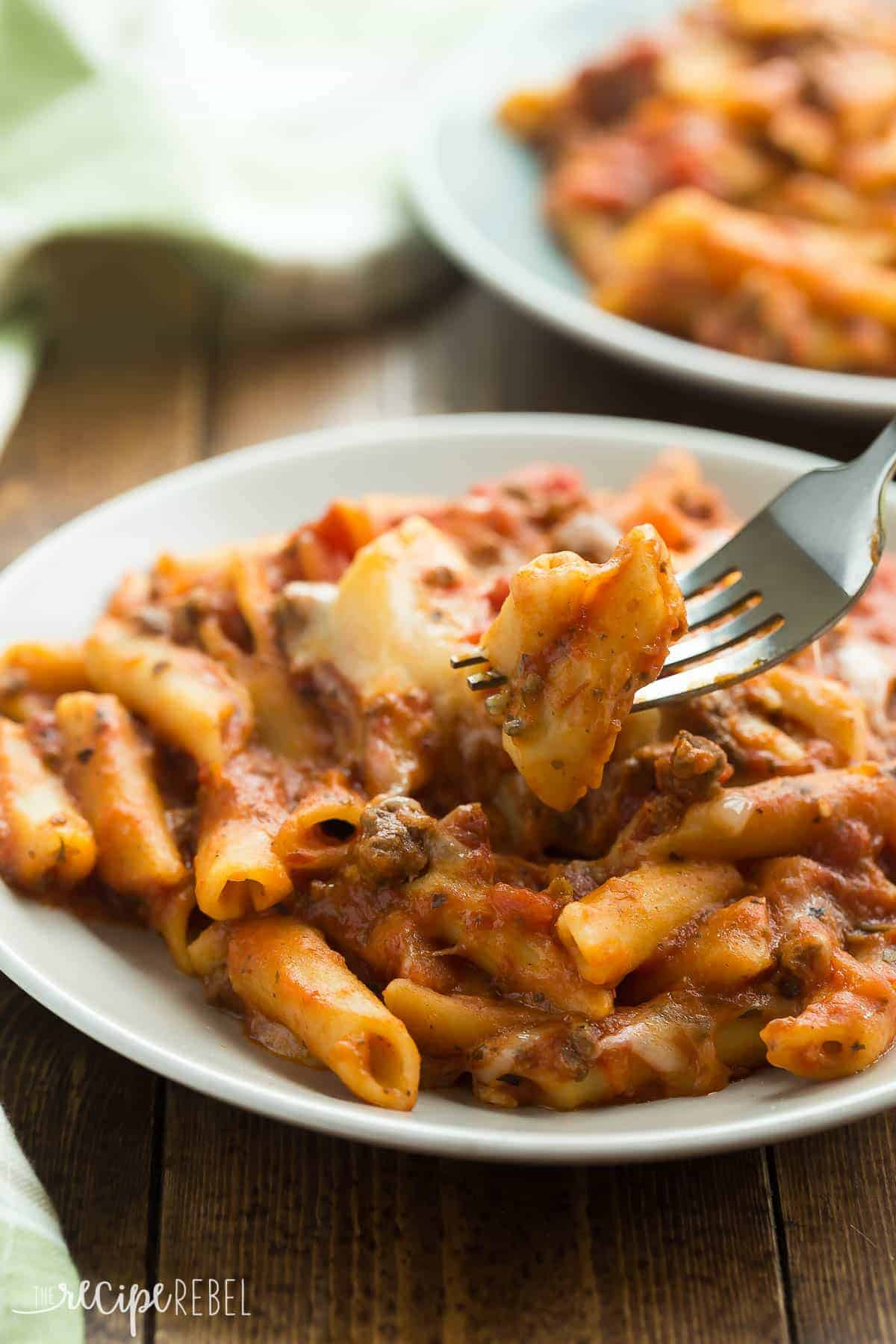 This Slow Cooker Baked Ziti is actually made completely in the crockpot -- even the pasta! It is so much easier than the traditional version but packs all of the same flavor!